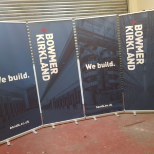 Four roller banners printed at Printscene for Bowmer & Kirkland. Each stood side by side.